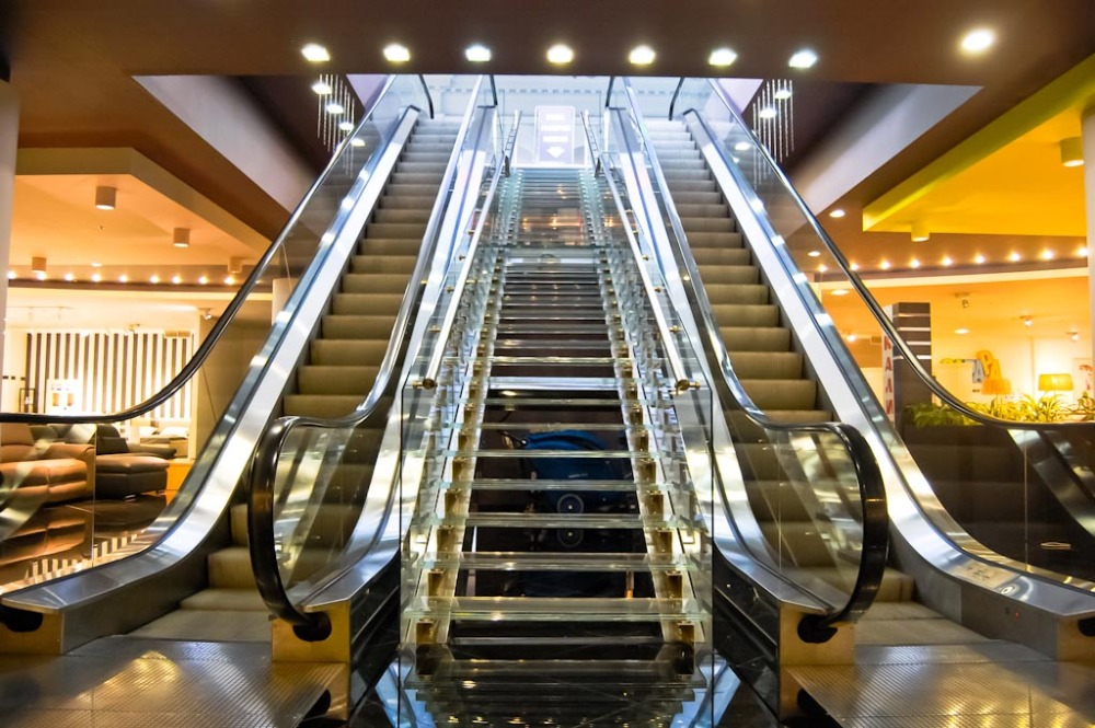 What is the difference between an elevator and an escalator